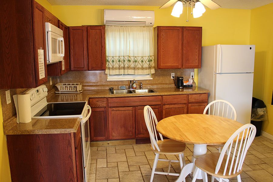 A Panama City Beach motel room with a kitchenette.