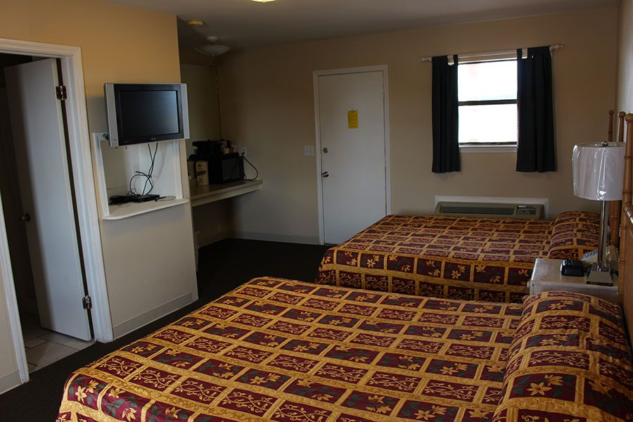 hotel room with two beds and tv