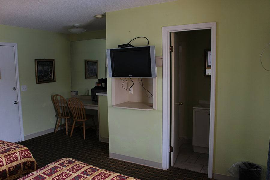 TV in room with two beds