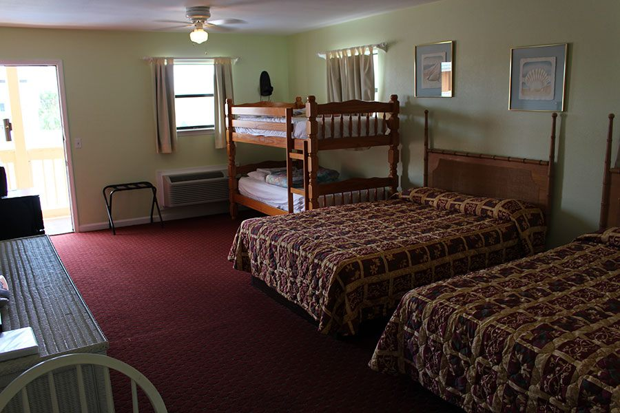 room with two beds and bunk beds