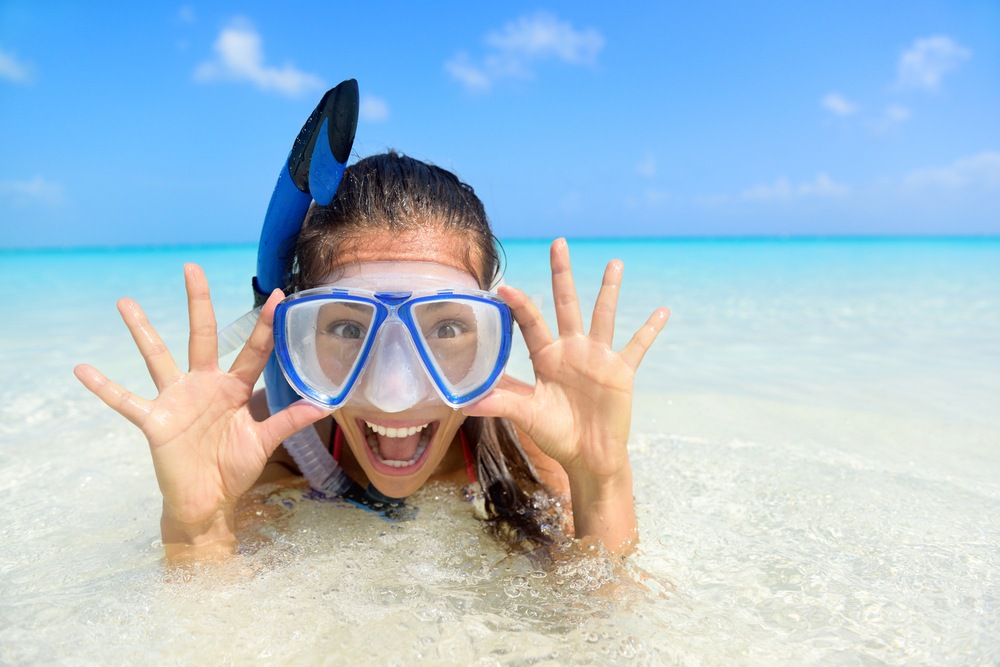 woman with snorkel mask on beach