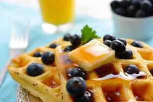 Blueberry waffles with butter and syrup