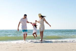 Family takes a stroll along the beach