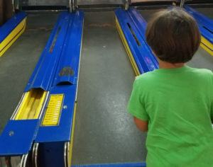 boy-playing-arcade-game