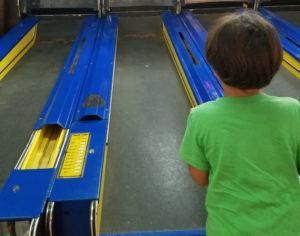 boy-playing-arcade-game